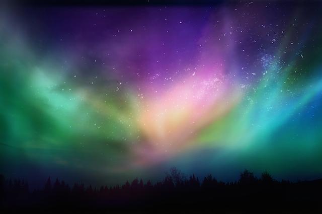 星空を覆い尽くす虹色のオーロラ