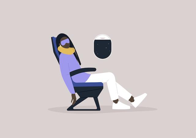 航空機のシートで眠る人のイメージ